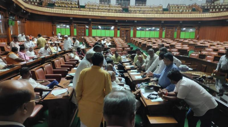 Karnataka Ministers MB Patil and DK Shivakumar in conversation with BJP MLAs include state BJP chief BS Yeddyurappa at Karnataka assembly after BJP MLAs said they would sit on an over night 'dharna' in the house demanding consideration of floor test today. (Photo: ANI | Twitter)