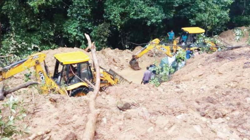 A major landslide that occurred on NH 75 in the Charmadi Ghat a few days ago.  (DC)