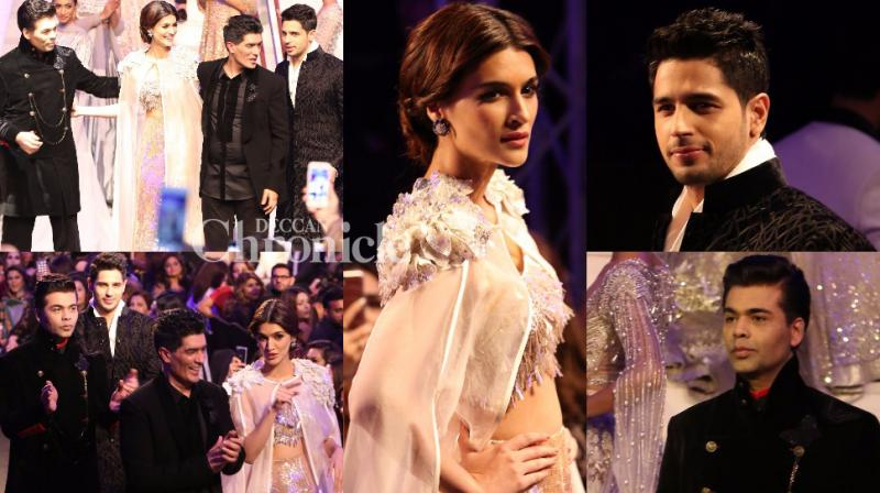 Karan Johar, Sidharth Malhotra and Kriti Sanon walked the ramp for Manish Malhotra at a fashion show in Dubai on Friday. (Photo: Viral Bhayani)