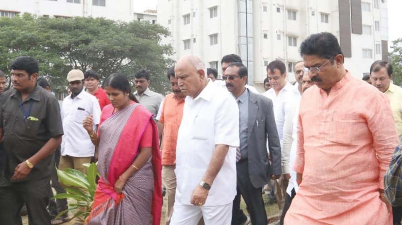 CM B.S. Yediyurappa with DyCM Dr. Ashwathnarayana, ministers Basavaraj Bommai, R. Ashok, Mayor Gangambike Mallikarjuna, MP P.C. Mohan and others during CM's city rounds, in Bengaluru on Sunday. (Photo: DC)