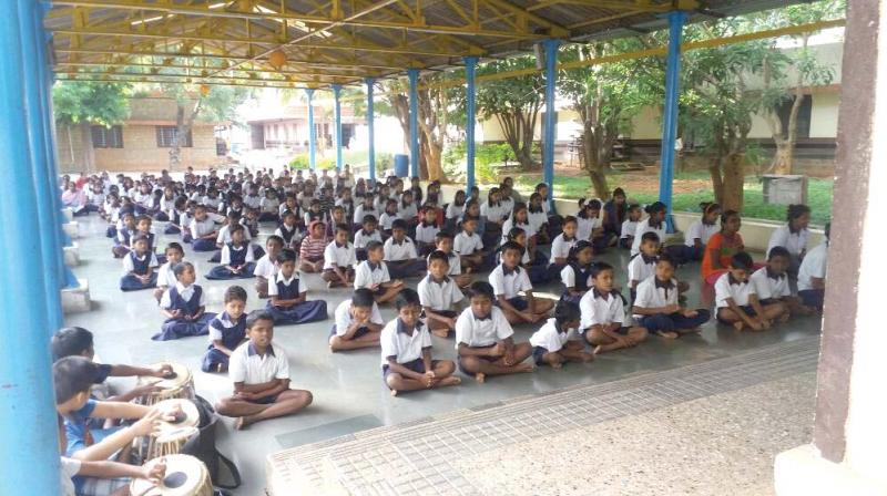 Children at the morning assembly at BGMS campus in Bengaluru (top). Children celebrate the Sankranti festival (right)