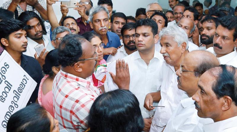 Former chief minister Oommen Chandy along with Muslim League general secretary P.K. Kunhalikutty and HIbi Eden, MP, interacts with flat owners at Maradu in Kochi on Monday. (Photo: DC)