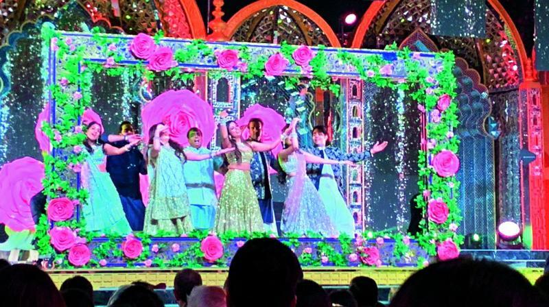 The Ambanis performing at the sangeet.