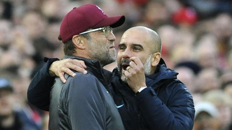 A potential 13 more games lie between Pep Guardiola's men and a clean sweep of FA Cup, Premier League and Champions League to add to the League Cup they lifted in February. (Photo: AP)