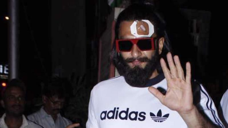 Ranveer Singh exiting Lilavati hospital after being treated.