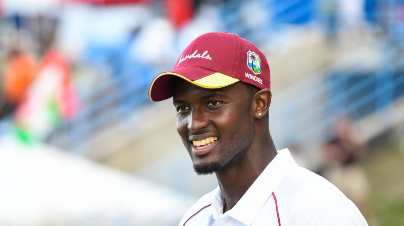 Holder's five wickets haul has lifted him four places to a career-best sixth position in the Test rankings after the Windies scored an impressive 10-wicket win over England to take an unbeatable 2-0 lead in the three-match series. (Photo: AFP)