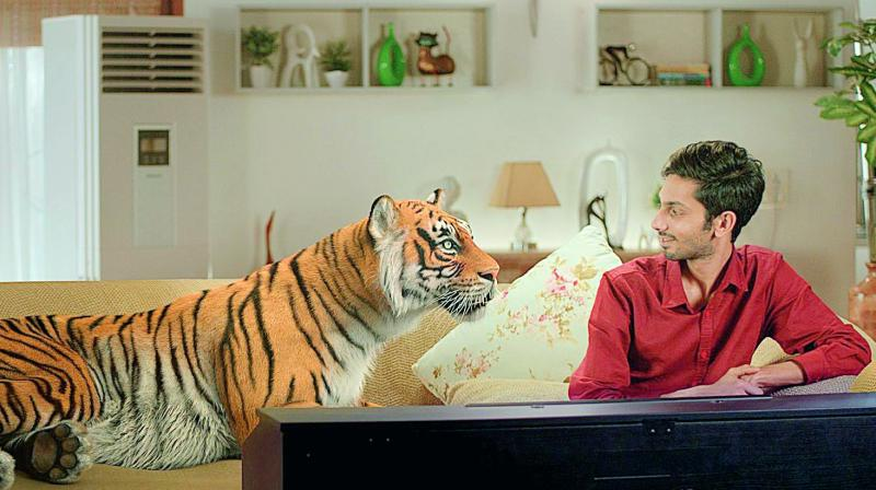 In the video, Anirudh is seen composing music for the movie alongside a tiger which is completely created through CG.