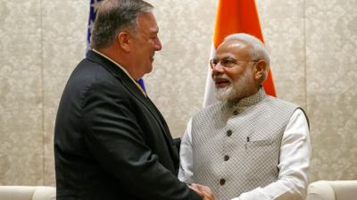 Secretary of State Mike Pompeo, left, shakes hands with Indian Prime Minister Narendra Modi, during their meeting at the Prime Minister's Residence. (Photo: AP)