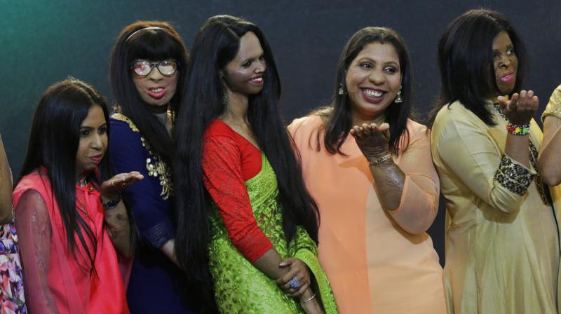 Acid attack victims pose on a ramp during a fashion show on the eve of International Women's Day in Thane, outskirts of Mumbai. (Photo: PTI)