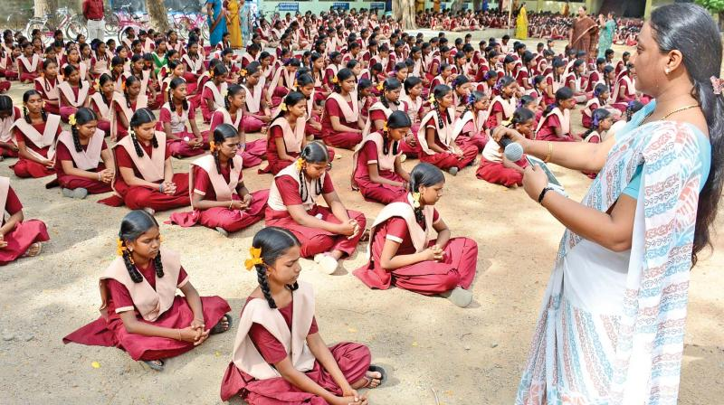 A teacher plays a melody for students at the morning prayer session. (Photo: DC)
