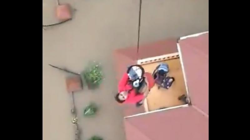 The woman was airlifted to a helicopter by a rescue worker harnessed to a safety rope. (Photo: Twitter Screengrab   @indiannavy)