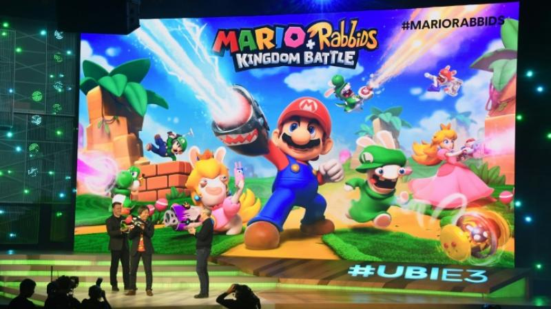 Ubisoft CEO Yves Guillemot (R) and game designer and producer Shigeru Miyamoto (C) introduce