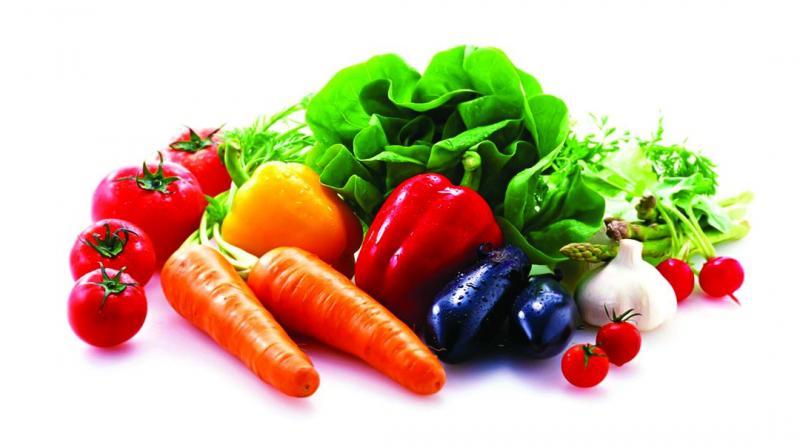c29eaa944 Locally grown vegetables like tomato, teasel gourd (kantola), green chillies,  cauliflower
