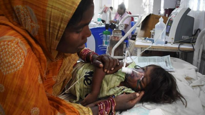 Madhya Pradesh health officials are also on alert after a man said doctors at a private hospital told him his eight-year-old son, who died on Sunday, was suffering from AES. (Photo: AFP)