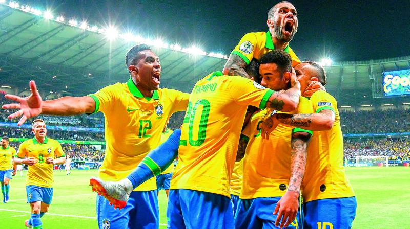 Brazil players celebrate a goal against Argentina during their Copa America semifinal at the Mineirao Stadium in Belo Horizonte, Brazil, on Wednesday. (Photo: AFP)