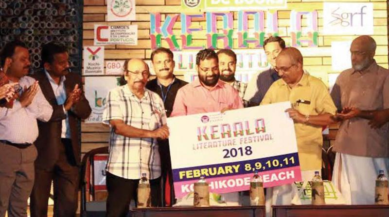 Tourism Minister Kadakampally Surendran launches the logo of 2018 Kerala Literature Fest at the valedictory ceremony at Kozhikode Beach on Sunday. KLF Director K. Satchidanandan, Kozhikode North MLA A. Pradeep Kumar among others look on. (Photo: DC)