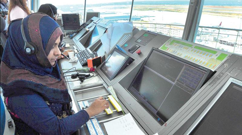 "I wear a burqa to work every day,"" says 31-year-old Nasira Bano, an operations executive in the flights departure management section of  the Kempegowda International Airport,"
