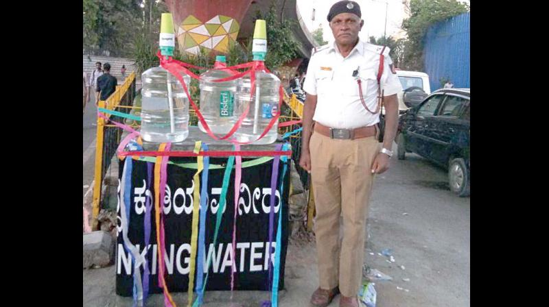 Assistant sub-inspector Nagesh Rao near the free water kiosk at Richmond Circle