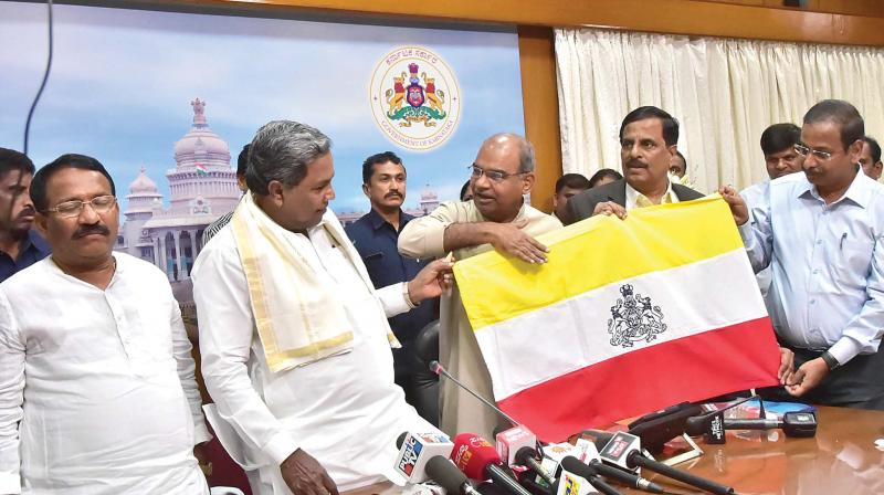 Chief Minister Siddaramaiah at the function where the proposed Kannada flag was unveiled, in Bengaluru on Thursday.