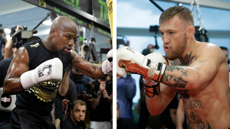 Move for lighter gloves is widely seen as benefiting both fighters as Mayweather's fast hands could be quicker with lighter gloves, while McGregor will be able to make his punching power more keenly felt.(Photo:AP)