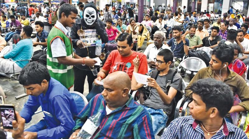 Dengue awareness camps conducted by Southern  Railway officials at Chennai Central station on Thursday.(Photo: DC)
