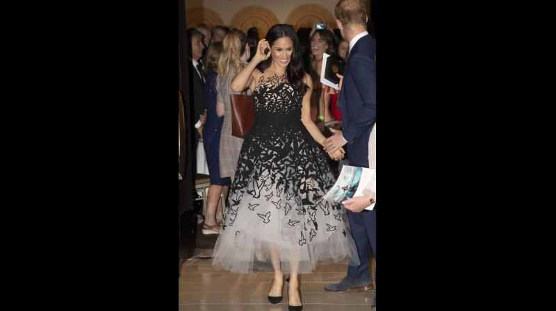 Britain's Prince Harry, right, and Meghan, Duchess of Sussex, attend the Australian Geographic Society Gala Awards event in Sydney, Australia, Friday Oct. 26, 2018. (Photo: AP)