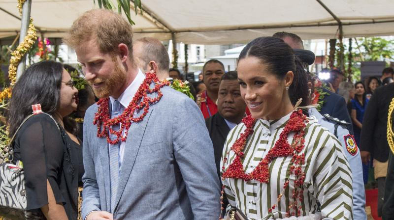 Britain's Prince Harry and Meghan, Duchess of Sussex wear a ta'ovala, a traditional Tongan dress wrapped around the waist, at the Fa'onelua Convention Centre in Nuku'alofa, Tonga, Friday, Oct. 26, 2018. (Photo: AP)
