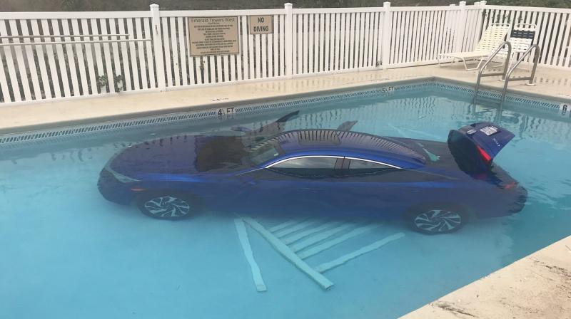 Car land in pool with father and child still inside. (Photo: Facebook /Okaloosa County Sheriff's Office)