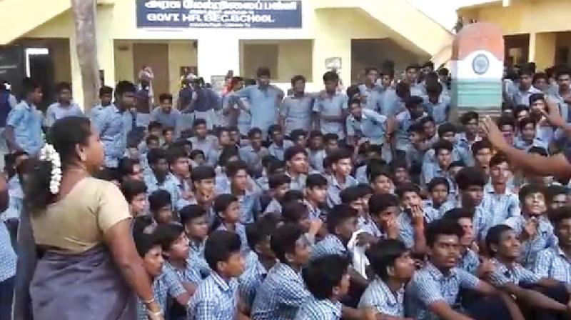 Students of Anakaputhur government higher secondary school stage a protest demanding  action against the accused. (Photo: DC)
