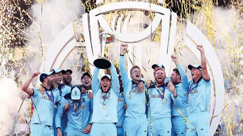 England players celebrate a New Zealand wicket during the World Cup final at Lord's Cricket Ground in London on Sunday. (AFP)