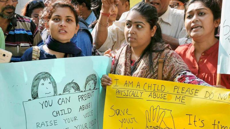 Students were allegedly threatened with deducting marks or withholding admit cards, in exchange for silence, the post mentions. In picture: Parents of the G D Birla school students protest outside campus. (Photo: PTI)
