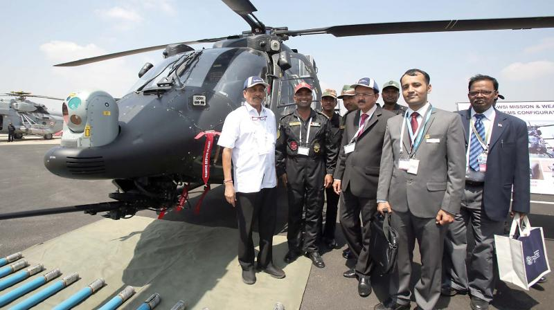 Defence Minister Manohar Parrikar with officials in front of ALH Rudra 	 (Photo: Samuel R)