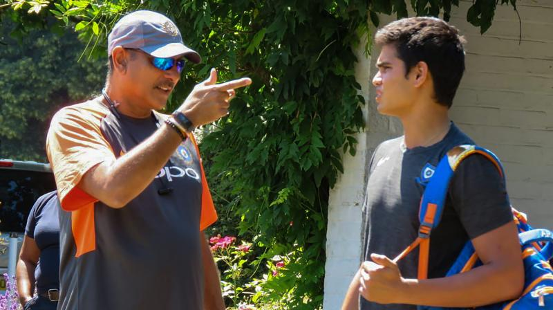 """Arjun Tendulkar, who has often trained with the Indian team and last year, bowled to the England Test team, received some """"words of wisdom"""" from the Indian cricket team coach Ravi Shastri. (Photo: PTI)"""