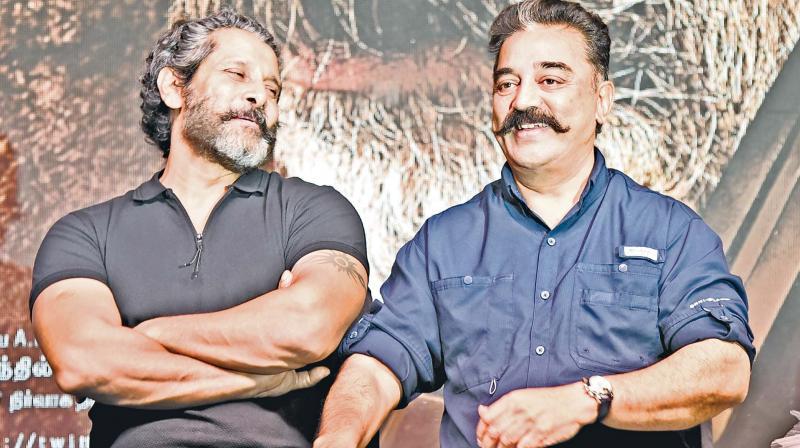 Vikram (L) and Kamal Haasan (R)