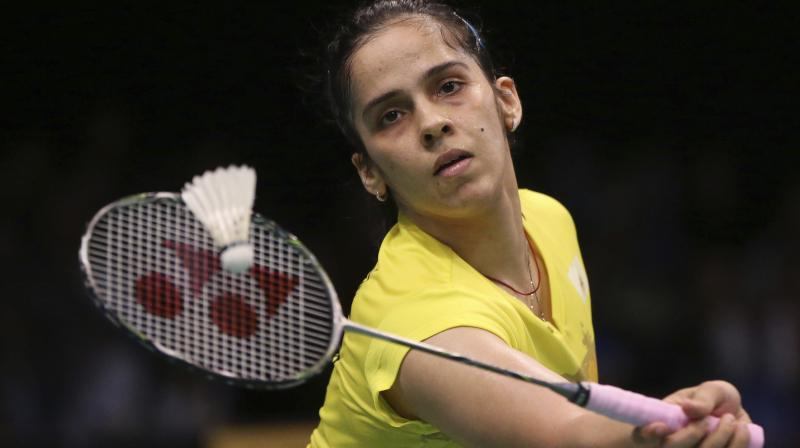 Saina, seeded seventh, took 39 minutes to tame Hong Kong's Pui Yin Yip 21-14 21-16 in her second round women's singles encounter. (Photo: AP)