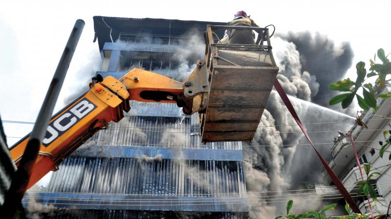 Fire breaks out at the six-storeyed building of Paragon footwear godown cum office in Kochi on Wednesday.   (SUNOJ NINAN MATHEW)