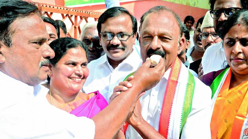 Vijayawada city Congress president V. Gurnatham offers sweets to PCC president N. Raghuveera Reddy and others, welcoming the statement of UPA chairperson Sonia Gandhi on giving special status to AP, at Andhra Ratna Bhavan in Vijayawada on Saturday.  (DECCAN CHRONICLE)