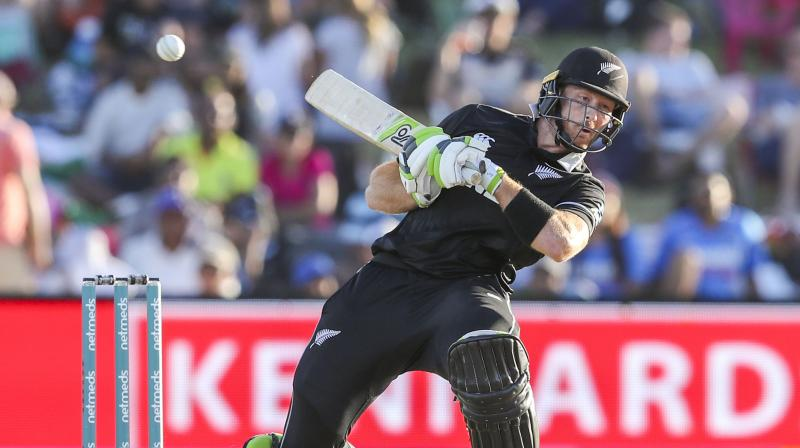 Guptill looked in pain as he walked off the ground with the help of New Zealand physiotherapist Vijay Vallabh and security manager Terry Minish. (Photo: AP)