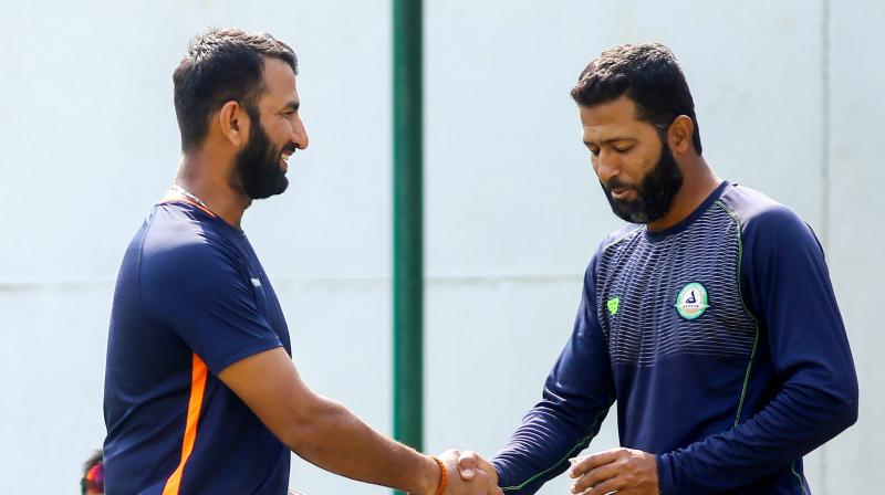 The battle lines are drawn and the summit clash will not just be about Pujara and Umesh only but also about Wasim Jaffer, who is a domestic doyen in every sense of the terms. (Photo: PTI)