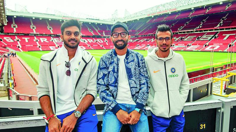 Vijay Shankar (from left), Dinesh Karthik and Yuzvendra Chahal at Old Trafford, the home of English (football) Premier League giants Manchester United. (Photo: Twitter)