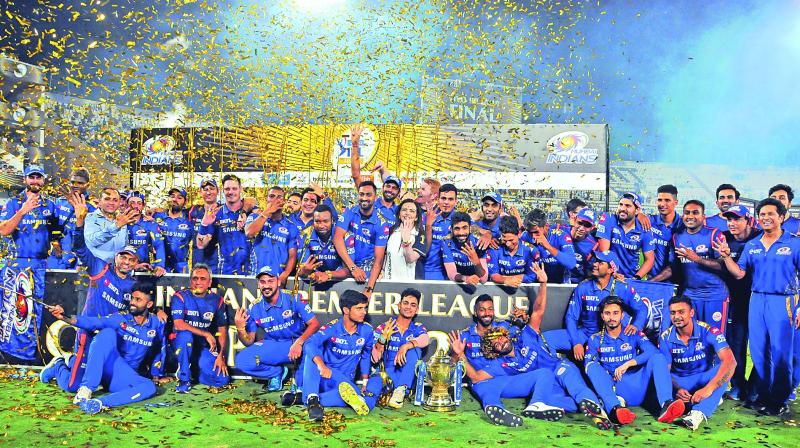 Players and support staff of Mumbai Indians pose after winning their fourth IPL trophy on Sunday. (Photo: P. Surendra)