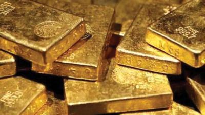 Spot gold was down 0.8 per cent at USD 1,433.63 per ounce as of 0548 GMT, after hitting a two-week high of USD 1,446.10 earlier in the session. (Photo: File)