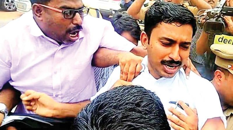 Mukkam police arrests the Youth League workers in front of AEO's office at Mukkam in Kozhikode on Monday.