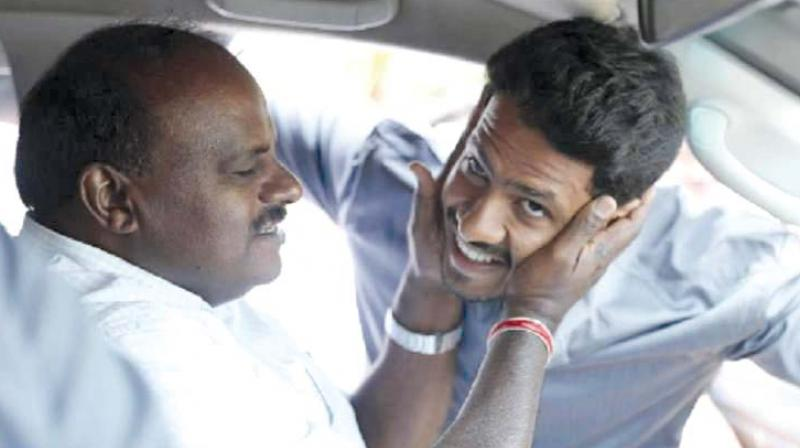 Chief Minister H.D. Kumaraswamy and son and Mandya JD(S) candidate Nikhil in a file photo.