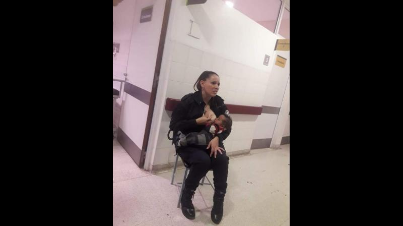 Argentina police officer breastfeeds malnourished baby in viral photo, receives promotion