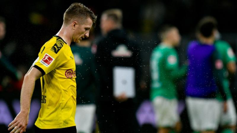 Marco Reus shows his disappointment after Dortmund drew another game in a row. (Photo:AFP)