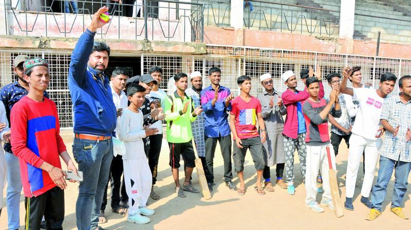 Children cheer madrasa students who participated in the two-day cricket match organised for the first time by a social organisation in the Old City on Thursday.