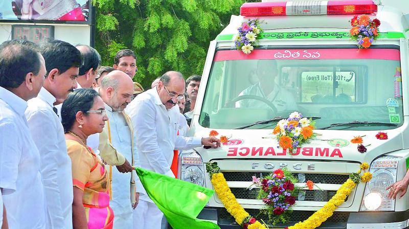 BJP national president Amit Shah flags off an advanced emergency ambulance at Vijayawada airport on Thursday. Health minister Kamineni Srinivas and MP Gokaraju Gangaraju are also seen. (Photo: DC)