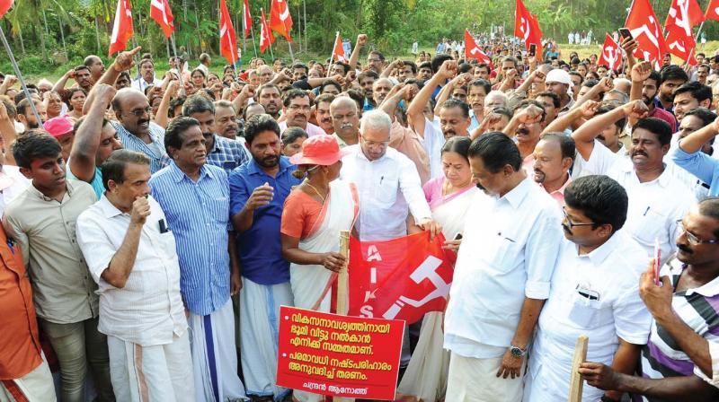 CPM leaders under the banner of 'Keezhattoor Janakeeya Samrakshana Samiti' lead a march from Keezhattoor paddy field in Kannur on Saturday.