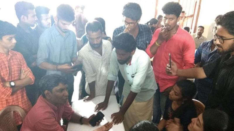 Students protest at the Kerala University Youth Festival venue at Kollam on Saturday alleging move to sabotage the results